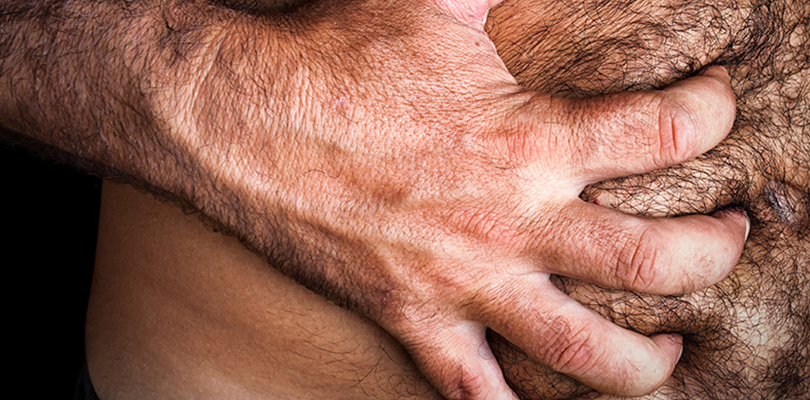 Man is in excruciating abdominal pain holds onto stomach