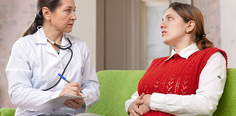 A patient discusses her symptoms with doctor
