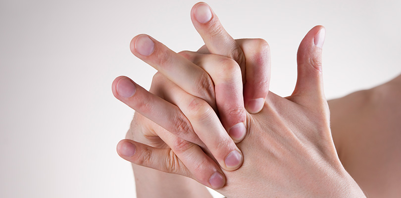 A person is cracking their knuckles