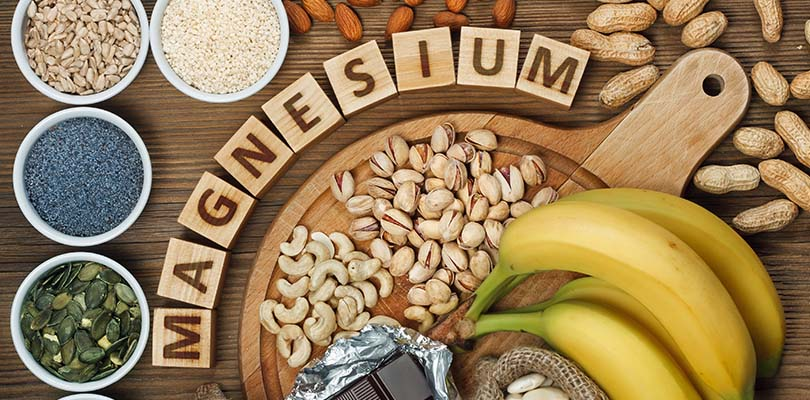A variety of magnesium-rich foods lay on a table