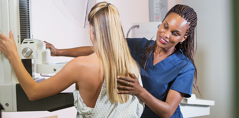 A woman is getting a breast exam