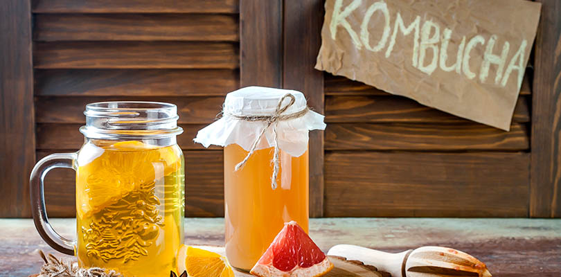 Two mason jars of kombucha are on a table