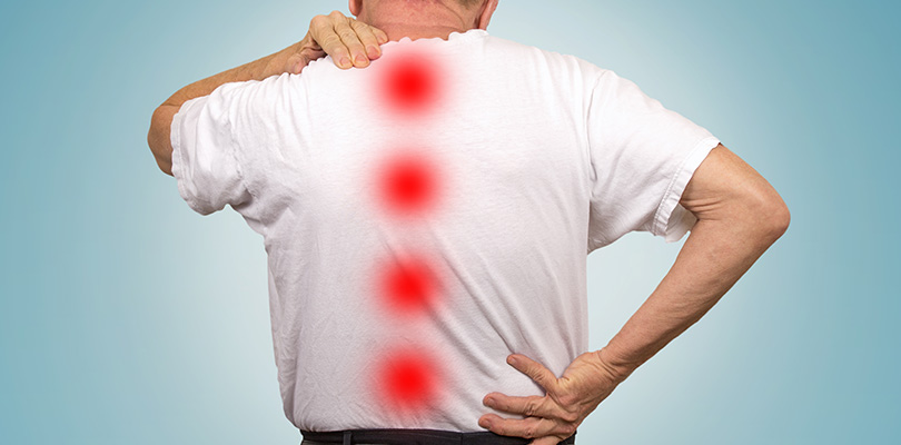 A man is experiencing spinal stenosis pain