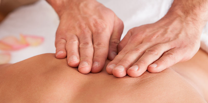 A person is receiving acupressure