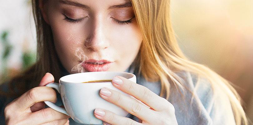Women drinking hot beverage