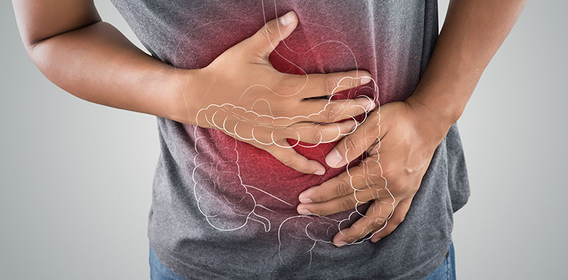 The photo of large intestine is on the man's body against gray background