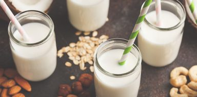 Vegan alternative nut milk in glass bottles