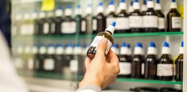 Pharmacist holding a medicine bottle in hand