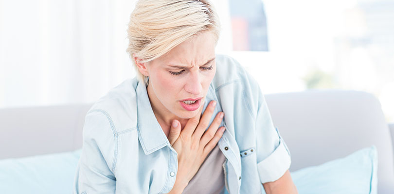 Woman having breath difficulties in the living room