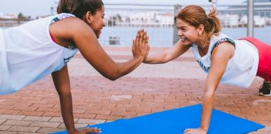 Two women exercising.