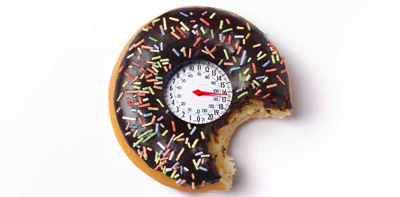 A sprinkle donut with a blood pressure meter in the center.