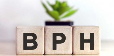 The letters BPH on sand colored blocks.